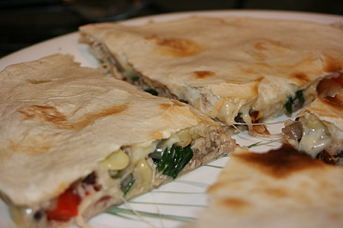 Chicken and Veggie Quesadillas jacked up with chicken, red pepper, mushrooms, onions, black beans and corn.